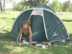 в палатке.